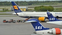 SAS planes and an Icelandair plane are parked as they wait to be able to leave from Arlanda airport Stockholm, Sweden May 19, 2016. Johan Nilsson/TT News Agency via Reuters ATTENTION EDITORS - THIS IMAGE WAS PROVIDED BY A THIRD PARTY. FOR EDITORIAL USE ONLY. SWEDEN OUT. NO COMMERCIAL OR EDITORIAL SALES IN SWEDEN. NO COMMERCIAL SALES. - D1AETEYGRSAB