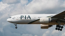 LONDON, UK - AUGUST, 3 2013; A Pakistan International Airlines (PIA) Boeing 777-240(ER) lands at Heathrow Airport in London