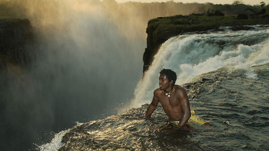 The Devil's Swimming Pool is shallow natural pool atop Victoria Falls.