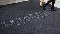 Women walk across a carpet outside of the Trump Soho Hotel in New York April 9, 2010. The first Trump Hotel built in Downtown New York, a 46-story, 391-room luxury hotel condominium, opened to guests on Friday.   REUTERS/Jessica Rinaldi (UNITED STATES - Tags: BUSINESS TRAVEL) - RTR2CMFW