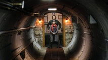 In this Nov. 2, 2017 photo, Mathew Fulkerson and his wife Leigh Ann pose at their Subterra Airbnb located in a former underground missile silo base near Eskridge, Kan. The Subterra Castle Airbnb opened for business about six months ago (Thad Allton/The Topeka Capital-Journal via AP)