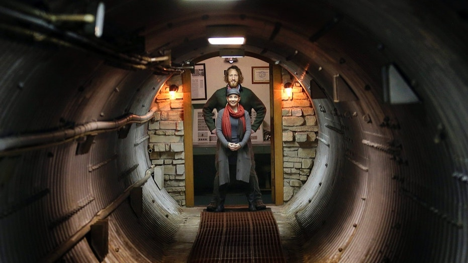 In this Nov. 2, 2017 photo, Matthew Fulkerson and his wife Leigh Ann pose at their Subterra Airbnb located in a former underground missile silo base near Eskridge, Kan. The Subterra Castle Airbnb opened for business about six months ago.