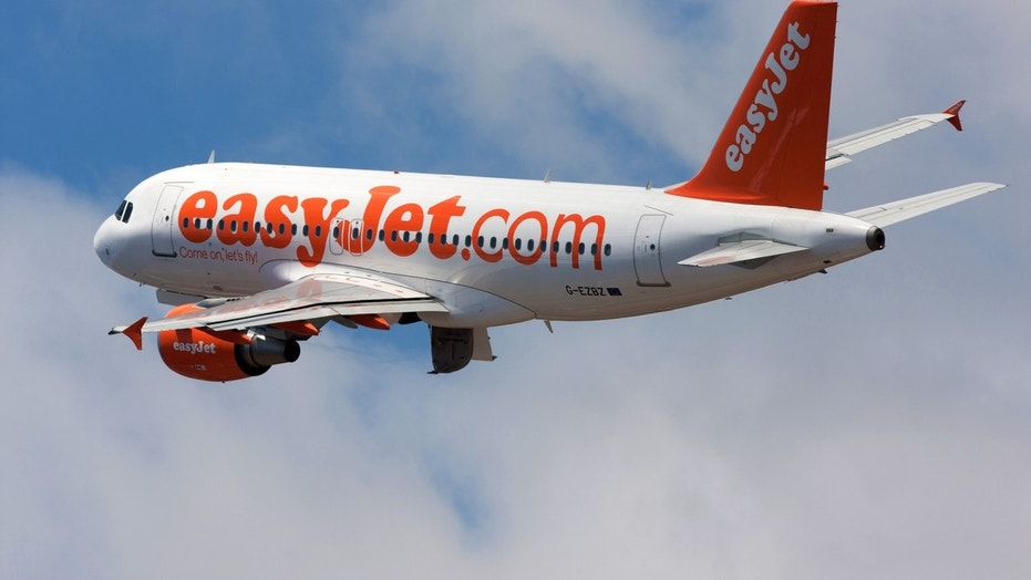 An engineer was caught on camera worrying passengers by repairing an EasyJet plane with adhesive tape.