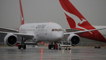 Qantas airline's first Boeing 787 Dreamliner aircraft to be delivered (front) sits on the tarmac of Sydney's International Airport in Australia, October 20, 2017 as a Qantas Airbus A380 passes behind.   REUTERS/Jason Reed - RC196FDD0000