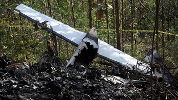 Pieces of a burned aircraft is seen at the site where the plane crashed in the mountainous area of Punta Islita, in the province of Guanacaste, Costa Rica January 1, 2018. Courtesy La Nacion/via REUTERS    ATTENTION EDITORS - THIS IMAGE WAS PROVIDED BY A THIRD PARTY. COSTA RICA OUT. - RC1A4EDFFF20