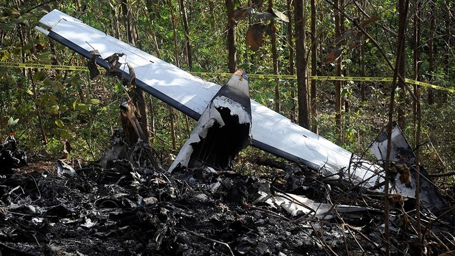 Jan. 1: Pieces of a burned aircraft are seen at the site where the plane crashed in the mountainous area of Punta Islita, in the province of Guanacaste, Costa Rica, killing 10 Americans and two crew members.  (Reuters)