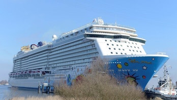 Spectators watch as the new cruise liner 'Norwegian Breakaway' leaves the German shipyard Meyer on the river Ems in Papenburg, northern Germany on March 13, 2013. The 4,000 passenger, 146,600-ton ship with its signature hull artwork designed by U.S. pop artist, Peter Max, is the largest cruise liner ever to be constructed in Germany and will arrive in her year-round homeport of New York City in early May 2013.   REUTERS/Fabian Bimmer (GERMANY - Tags: MARITIME TRAVEL) - BM2E93D146O01