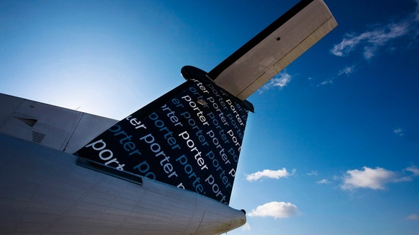 The back of a Porter Airlines Bombardier Q400 turboprop aircraft is seen in Toronto February 23, 2009.  Just two years after launch, niche airline Porter Airlines now flies routes to eight cities in eastern Canada and the United States. It remains profitable and is gearing up for expansion at a time when industry rivals are strapped for cash.    REUTERS/Mark Blinch (CANADA) - GM1E52O07ME01