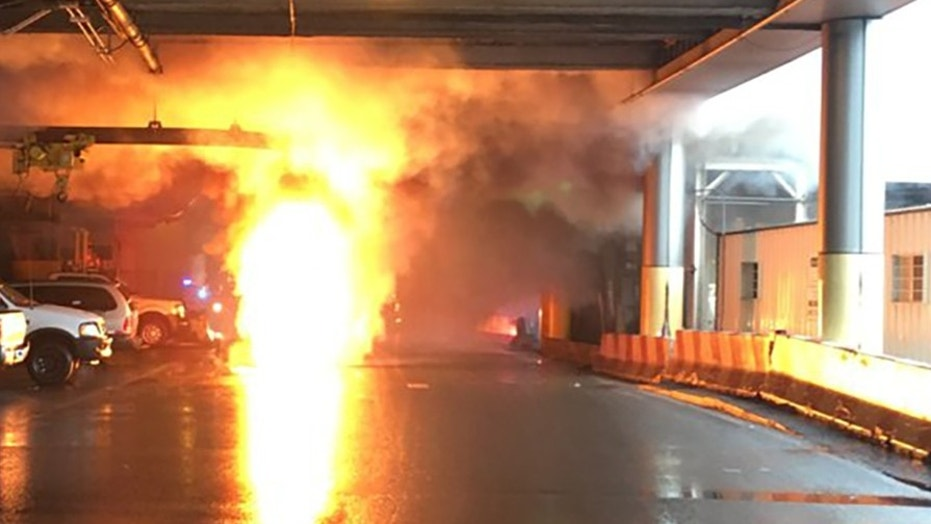 A transformer fire broke out in a manhole at New Jersey's Newark Airport, leading to a partial evacuation.