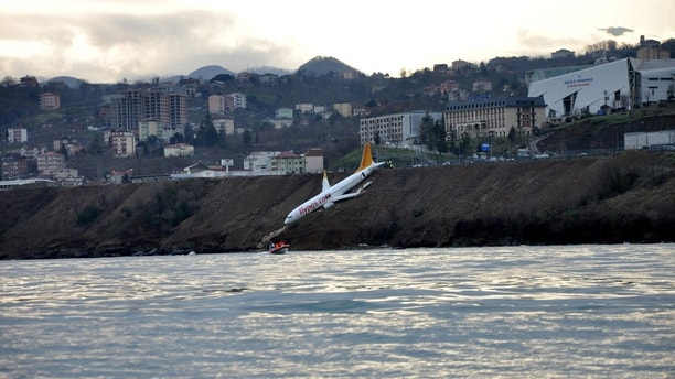 A Pegasus Airlines aircraft is pictured after it skidded off the runway at Trabzon airport by the Black Sea in Trabzon, Turkey, January 14, 2018. Muhammed Kacar/Dogan News Agency via REUTERS ATTENTION EDITORS - THIS PICTURE WAS PROVIDED BY A THIRD PARTY. NO RESALES. NO ARCHIVE. TURKEY OUT. NO COMMERCIAL OR EDITORIAL SALES IN TURKEY.     TPX IMAGES OF THE DAY - RC151B74A1C0