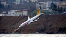 A Pegasus Airlines aircraft is pictured after it skidded off the runway at Trabzon airport by the Black Sea in Trabzon, Turkey, January 14, 2018. Muhammed Kacar/Dogan News Agency via REUTERS ATTENTION EDITORS - THIS PICTURE WAS PROVIDED BY A THIRD PARTY. NO RESALES. NO ARCHIVE. TURKEY OUT. NO COMMERCIAL OR EDITORIAL SALES IN TURKEY. - RC138933ED70