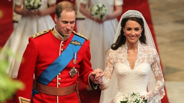 April 29, 2011: In this file photo, Prince William and his bride Kate walk down the aisle at Westminster Abbey, following their marriage, in London.