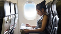 Young woman sits in a chair of the airplane