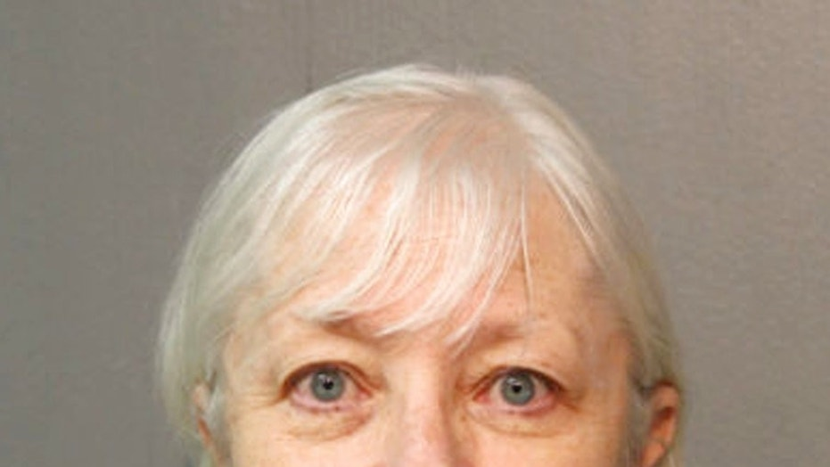 Marilyn Hartman's mugshot from an earlier arrest after being caught sneaking onto planes after what police say was a ticketless flight from Chicago to London.