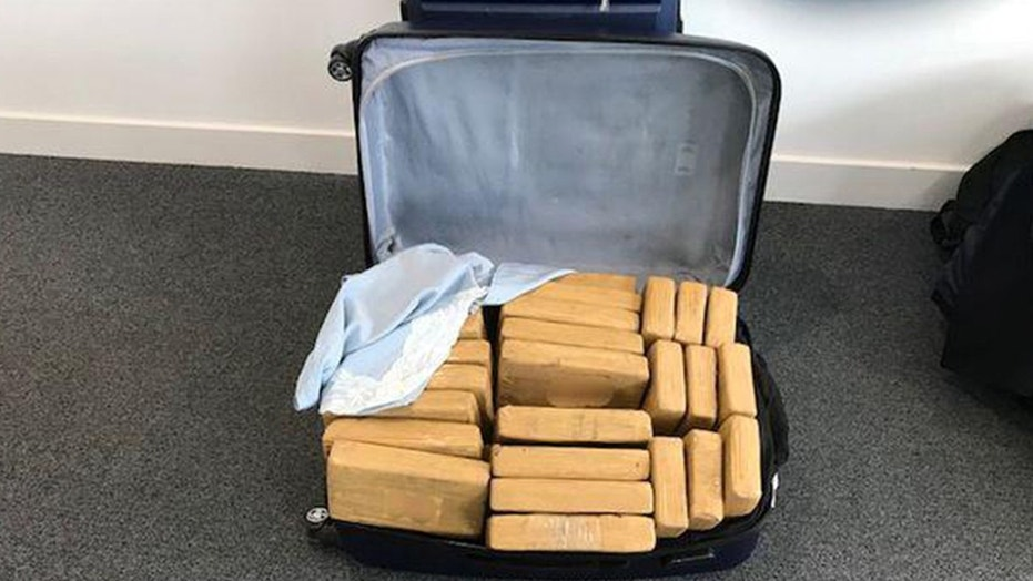 Officers discovered 15 suitcases full of cocaine at the Farnborough airport in England.