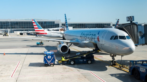 Travel  Delayed American Airlines flight leaves passengers angry, sleeping on airport floor
