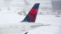 Delta airplanes are seen at gates during a snow storm in Boston, Massachusetts February 2, 2015. Boston, already buried under two feet (60 cm) of snow from a blizzard last week, was predicted to see a foot of snow after a huge winter storm hit the northeastern United States on Monday, the region's second snowy blast in less than a week. REUTERS/Dominick Reuter  (UNITED STATES - Tags: ENVIRONMENT TRANSPORT) - GM1EB230AJ001