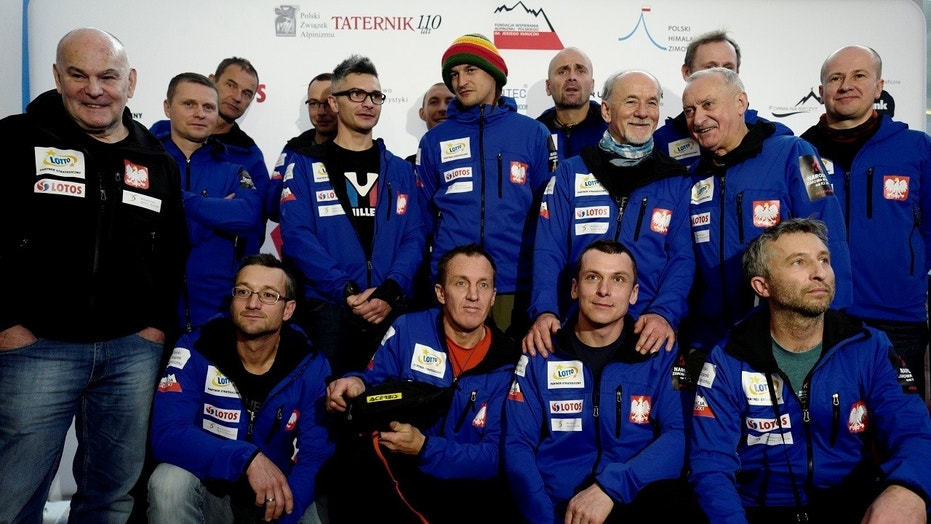 Polish mountaineers pose for a team photo prior their departure for the expedition to scale K2 in the winter, at an airport in Warsaw, Poland December 29, 2017.