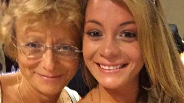 """Natalie, 27 with and her mum Anna, 58. See SWNS story NYUNITED. This is the moment a heated row erupted after airline staff repeatedly told a flier her carry-on bag was too large - despite it appearing to fit perfectly into their baggage rack. Fuming Natalia Rutkowski, 27, was checking in for a flight from Chicago to New Jersey with her mom Anna, 58, when """"rude"""" United Airlines staff confronted her about a handbag. Footage shows the account executive, of Lyndhurst, New Jersey, being asked to place the piece of luggage into a test rack at O'Hare International Airport. It appears to fit snugly inside the crate, but staff are seen arguing that it is oversized and instructing Natalia and her mom to check the bag for a $25 fee."""