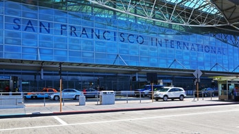 San Francisco, California, USA - August 23, 2013: Main entrance of San Francisco International Airport. Some peope are visible in front of it.