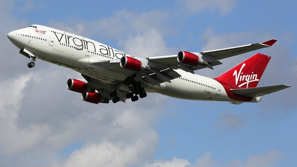 London Heathrow, United Kingdom - August 28, 2015: A Virgin Atlantic Boeing 747-400 with the registration G-VBIG taking off from London Heathrow Airport (LHR) in the United Kingdom. Virgin Atlantic Airways is a British airline with a base at London Heathrow airport.