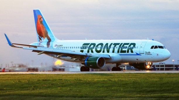 Cleveland, OH, USA - May 12, 2015: In the morning, Frontier Airlines A320 (Orville, the red Cardinal) just landed at Cleveland Hopkins International Airport.