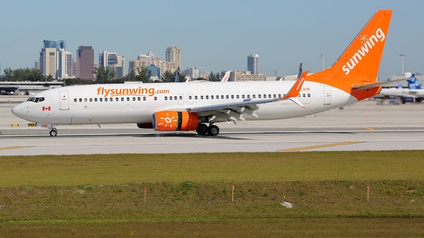 Fort Lauderdale, United States - February 17, 2016: A Sunwing Airlines Boeing 737-800 with the registration C-FLSW landing at Fort Lauderdale Airport (FLL) in the United States. Sunwing Airlines is an airline from Canada headquartered in Toronto.