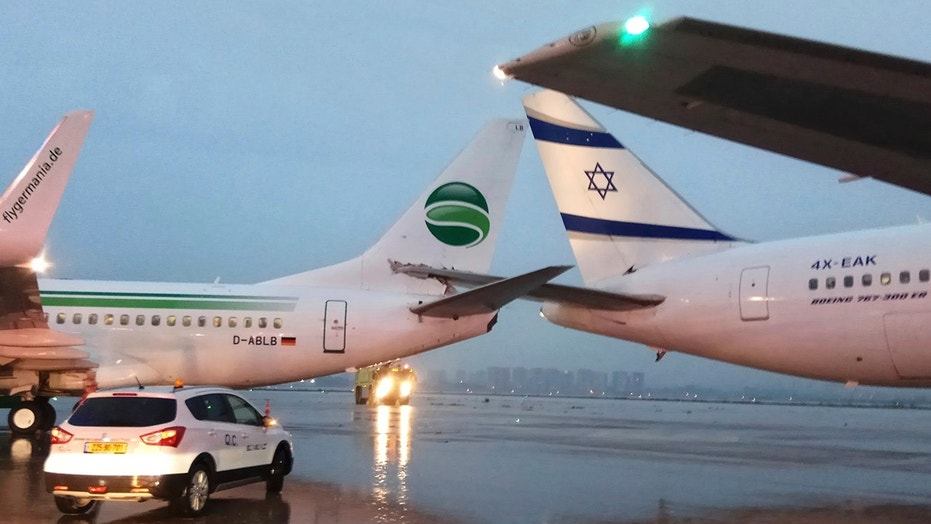 The tail end of a Germania aircraft headed to Berlin crashed into the tail end of an El Al flight bound for Rome early Wednesday.