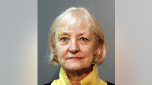 DELETES AGE REFERENCE- File-This Feb. 17, 2016 file photo provided by the Chicago Police Department shows Marilyn Hartman. Hartman, who has a history of sneaking aboard planes, slipped past security at Chicago's O'Hare International Airport this week and was flying to London when the airline realized she didn't have a ticket. Chicago Police spokesman Anthony Guglielmi says she was flown back to Chicago on Thursday, Jan. 18, 2018, and taken into custody once she arrived. He says burglary and theft charges are expected. (Chicago Police Department via AP, File)