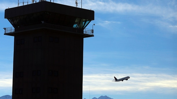 A Delta Airlines passenger jet takes off, a day before the annual Thanksgiving Day holiday, at the Salt Lake City international airport, in Salt Lake City, Utah, November 21, 2012.  REUTERS/George Frey (UNITED STATES  - Tags: TRAVEL TRANSPORT BUSINESS SOCIETY)   - TB3E8BM1ENVSM