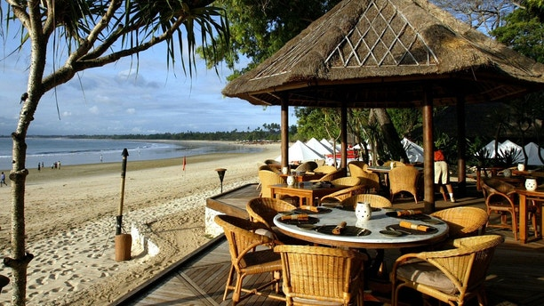 The Pantai Jimbaran, or PJ's, beachfront restaurant looks out over Jimbaran Bay at the Four Seasons Hotel on Bali, August 13, 2003. With room rates from $575 to $3500 per night, the Four Seasons Jimbaran Bay occupancy rate in August 2003 was approximately 51 percent, down from 85 percent during the same period in 2002. [Last year's deadly bombing attacks dealt a body blow to a tourist industry that provides a livelihood for 70 percent of the 3 million people living on this island of surfing beaches and lush rice paddies. In the first half of this year, only 411,864 tourists came to Bali, down 39.77 percent from the 683,765 in the same period last year, according to Indonesia's bureau of statistics.] - PBEAHUONNEA