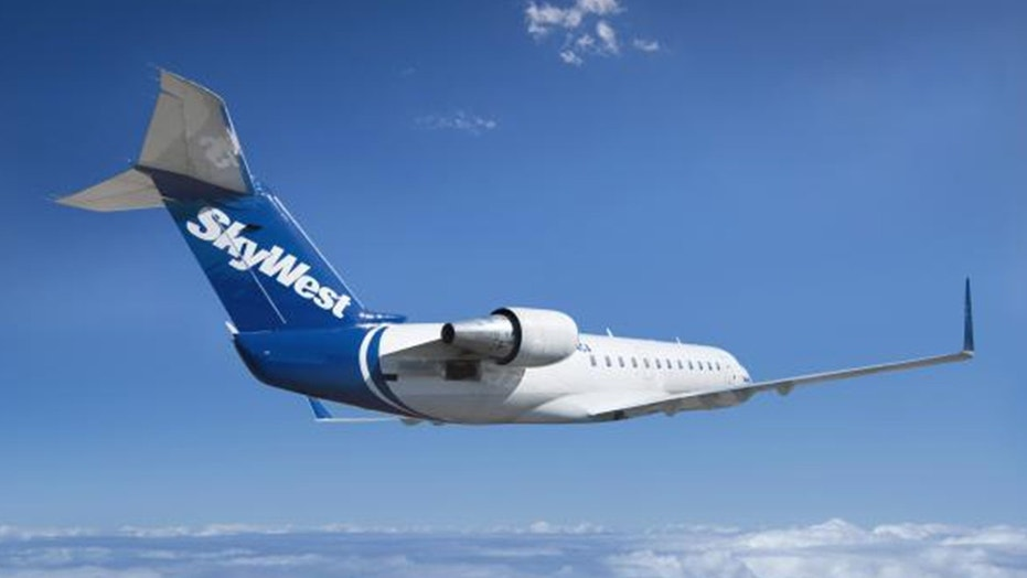 A flight attendant for SkyWest says the pilot drugged and raped her on a layover.