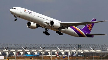 A Thai Airways Boeing 777-300ER plane takes off from Bangkok's Suvarnabhumi Airport February 23, 2015. REUTERS/Chaiwat Subprasom/File Photo   - S1BETEHINCAA