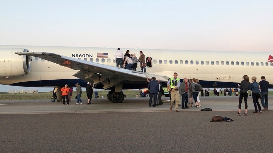 Passengers aboard a Delta Airlines jet were forced into an emergency evacuation moments after landing on the runway of Denver International Airport.