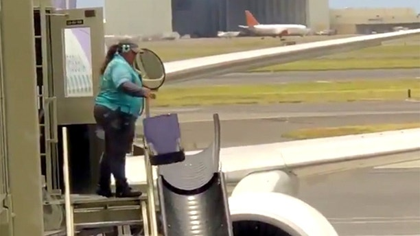 hawaii baggage03 Honolulu Airport worker caught tossing luggage sparks Twitter debate Honolulu Airport worker caught tossing luggage sparks Twitter debate 1527607330174