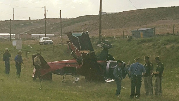 On May 31st, 2018, at approximately 5:50 p.m., a single passenger bi-plane was flying from Longmont, Co to Sky Park, UT. For reasons unknown, the plane's engine lost power. The pilot attempted to land the plane on Interstate 80. The plane struck the top of the sleeper berth on a tractor-trailer which was hauling pigs. The impact caused the pilot to lose control of the plane. The plane then struck a variable speed limit sign and crashed on the north side of I-80 near milepost 8. The pilot was not injured in the crash. The semi truck came to a controlled stop on the right shoulder of the highway. The driver of the semi-truck was not injured. The plane had severe damage to the wings and the prop. The semi-truck sustained damage to the sleeper section of the cab. The FAA and NTSB have been notified and will be taking over the investigation.