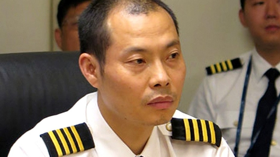 "The Chinese pilot, Liu Chuanjian, was awarded the five million yuan and the title of ""hero captain of China's civil aviation."""