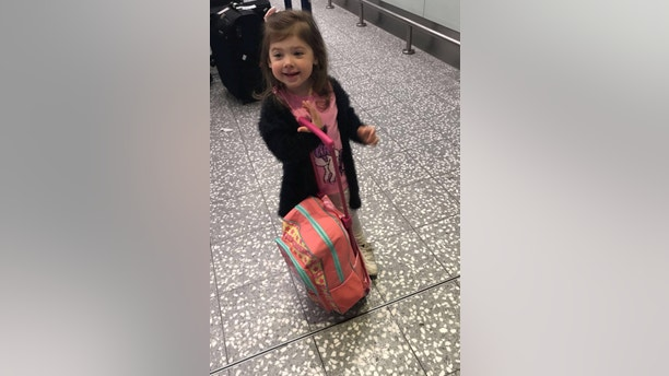 Hayley Lewis' daughter Syndney Hedges at the airport. See SWNS story SWPASSPORT; A young mum missed her three-year-old daughter's first flight - because there was a tear in her passport. Hayley Lewis, 28, had booked a family holiday to Menorca, Spain, with her daughter, Syndney Hedges, mother, Sally Lewis, 48, and disabled gran, Jane Wozencroft, 72.The clan headed to the airport but disaster struck when an airport worker refused to let Hayley on the plane because a page of her passport was torn. They noticed the rip at the last possible check as Hayley was about to board the plane, and refused to let her on board.