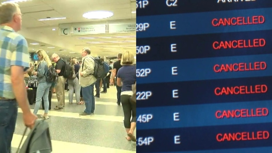 Hundreds stranded at Charlotte airport because of technical issue