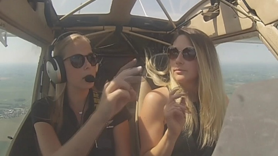 Instructor Andrea Hynek and Julia Velasquez enjoy a flying lesson in the high skies.