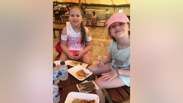 Rose (right), 5, and Lois (left),  9, daughters of Janet Alexander from Inverness, Higland, on holiday. Janet is suing Thomas Cook after she claims her daughter, Rose 5, was abducted while on holiday in Turkey. See Centre Press story CPSUE; A mum-of-two who claims her daughter was abducted from a hotel kids club in Turkey is suing Thomas Cook. Janet Alexander, 46, spoke about her legal action following the terrifying ordeal at the Royal Wings Hotel in Antalya. The single mum left Rose, aged five, at the resort's supervised play area so she could take her eldest daughter Lois, aged nine, to a scuba diving lesson. But when Janet returned around an hour later Rose was missing – and hotel staff didn't even know she was gone.
