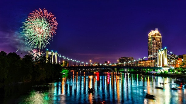 Fireworks Over River in Downtown Minneapolis Celebrating Independence Day.