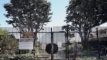 This Aug. 31, 2016, photo shows the gate to Opal Cliffs Park that leads to Opal Cliffs Neighborhood Beach, more commonly known as Privates surf break, in the Live Oak neighborhood of an unincorporated part of Santa Cruz County, Calif. The California Coastal Commission will decide whether access to a secluded beach can be restricted by a 9-foot iron fence, locking gate with a 0 annual key fee and a gate attendant. The commission on Thursday, July 12, 2018 will vote on whether the resident-run program that has regulated access to Santa Cruz County's Privates Beach for more than 50 years is allowed to continue. (Dan Coyro/Santa Cruz Sentinel via AP)