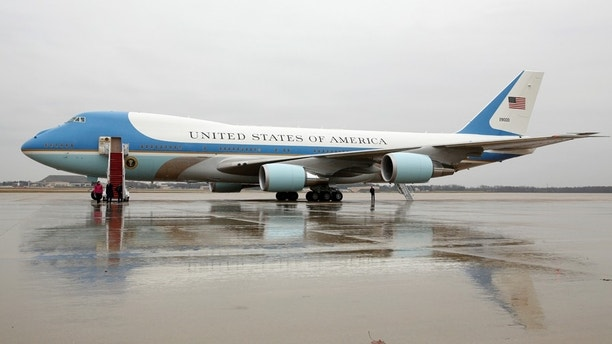 "Air Force One sits on the tarmac at Joint Base Andrews in Maryland U.S. December 6, 2016, the same morning that U.S. President-elect Donald Trump urged the government to cancel purchase of Boeing's new Air Force One plane saying it was ""ridiculous"" and too expensive.  REUTERS/Kevin Lamarque - RC12052AD940"