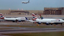 FILE - In this Friday, Dec. 12, 2014 file photo, aircraft wait on the tarmac at Heathrow Airport in London. A collision between a British Airways passenger jet and a drone left the plane undamaged, but the aviation industry shaken. British police and air-accident authorities are investigating the incident which occurred on Sunday, April 17, 2016, in which an Airbus A320 carrying 137 people struck an object believed to be a drone while it was approaching Heathrow Airport. (AP Photo/Vadim Ghirda, file)
