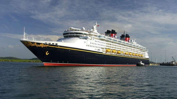 The Disney Magic cruise ship sails on a section of the Panama Canal May 16, 2008. The U.S.-owned cruise ship has paid a record $331,200 to cross the Panama Canal as vessels fight for space in the increasingly congested waterway, authorities said on June 10, 2008. The 964-foot (295-meter)-long Disney Magic, owned by a subsidiary of Walt Disney Co, broke the transit record on May 16, the Panama Canal Authority said. The ship sails out of Port Canaveral, Florida, and is registered in the Bahamas.  Picture taken May 16, 2008. REUTERS/Panama Canal Authority/Handout  (PANAMA) - GM1E46B0AU501