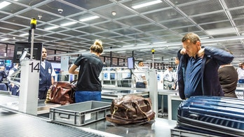 Frankfurt, Germany - June 18, 2015: people at security check at Frankfurt international airport in Frankfurt, Germany. In 2012, Frankfurt handled 57.5 million passengers.