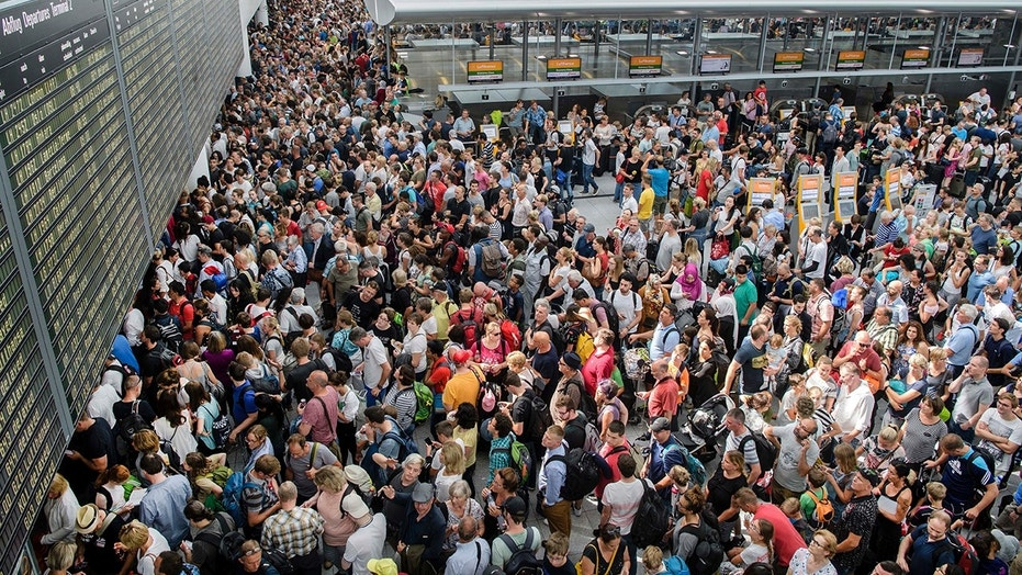 German authorities say they temporarily shut down parts of Munich airport because a woman entered a security zone without going through the security and passport controls.