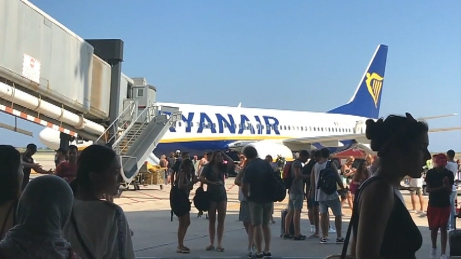 Ryanair passengers forced to evacuate plane after mobile phone bursts into flames