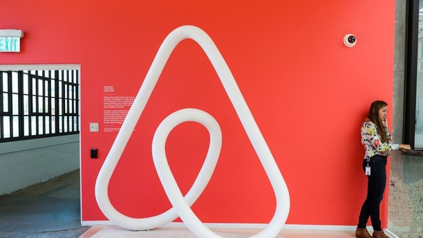 A woman talks on the phone at the Airbnb office headquarters in the SOMA district of San Francisco, California, U.S., August 2, 2016. REUTERS/Gabrielle Lurie - RC174B233910